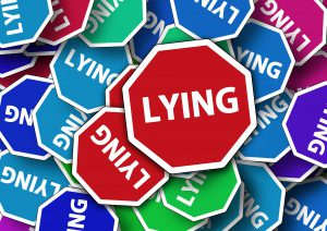 photo of an octogon with the word LYING