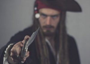 photo of a pirate pointing his knife towards you