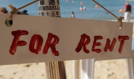 photo of a sign that says for rent