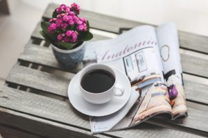 photo of coffee, magazine and flowers